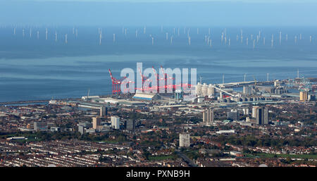 an aerial view of the Bootle Seaforth Docks skyline towards wind turbines in the Irish Sea, Liverpool - Stock Photo