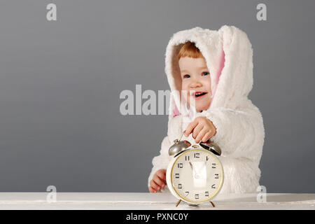 Portrait of a cute little girl dressed in Easter bunny suit. Greating card template. - Stock Photo