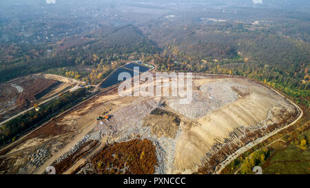 Aerial view of the big city dump. Smog formed in the sky. - Stock Photo