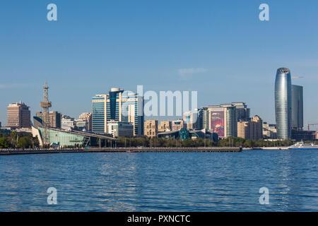 Azerbaijan, Baku, Bulvar Promenade, city skyine from Baku Bay - Stock Photo