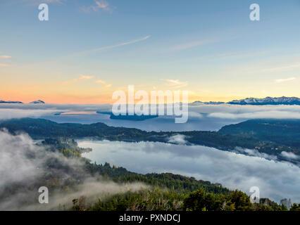 Nahuel Huapi Lake at sunrise, seen from Cerro Campanario, Nahuel Huapi National Park, Rio Negro Province, Argentina - Stock Photo