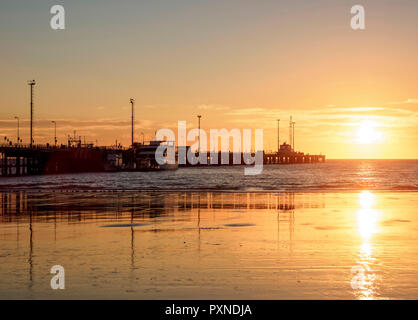 Comendante Luis Piedrabuena Pier at sunrise, Puerto Madryn, The Welsh Settlement, Chubut Province, Patagonia, Argentina - Stock Photo