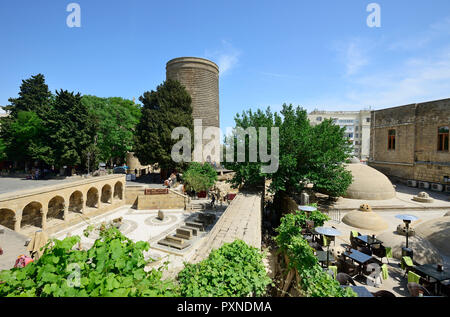 The Maiden Tower (Qiz Qalasi), a 12th century monument in the Old City, and Haji Bani Bath complex (Haji Gayib's bathhouse), a UNESCO World Heritage Site. Baku, Azerbaijan - Stock Photo