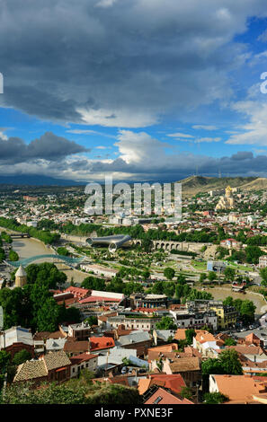 Tbilisi and the Mtkvari river. On the right the Holy Trinity Cathedral (Tsminda Sameba) of Tbilisi. Georgia, Caucasus - Stock Photo