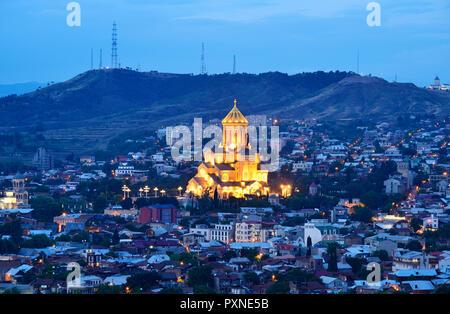 Holy Trinity Cathedral (Tsminda Sameba) the biggest Orthodox Cathedral in the Caucasus, at dusk. Tbilisi, Georgia. Caucasus - Stock Photo