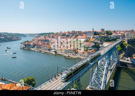 Portugal, Norte region, Porto (Oporto). Ribeira district (old town) and the Dom Luis I bridge over the Douro river. - Stock Photo