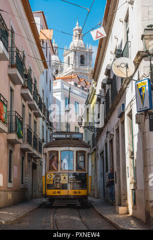 Portugal, Lisbon. The famous touristy line 28 of the Lisbon tramway in Alafama district. - Stock Photo