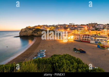 Portugal, Algarve, Faro district, Lagoa, Carvoeiro. Cityscape at dusk. - Stock Photo