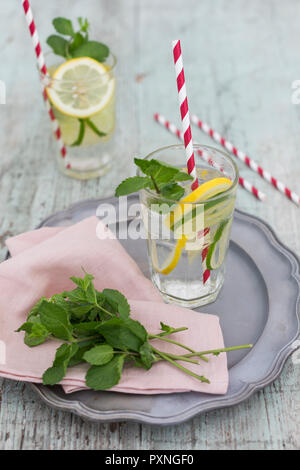 Glasses of infused water with lemon, lime and mint - Stock Photo