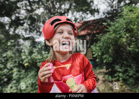 Portrait of laughing masqueraded little girl having fun