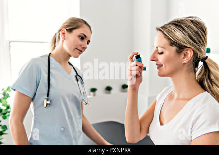 Asthma Woman with doctor at the hospital - Stock Photo