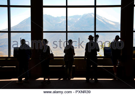 Tourists watching Mount St Helens from observatory through a window, Washington state - Stock Photo