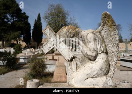 Old stone headstone at the Cemetery of the Greek Orthodox Patriarchate of Jerusalem on Mount Zion Jerusalem Israel - Stock Photo