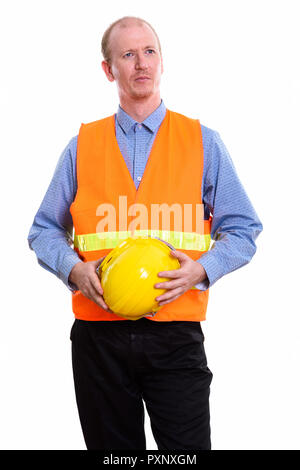 Thoughtful man construction worker holding safety helmet with bo - Stock Photo
