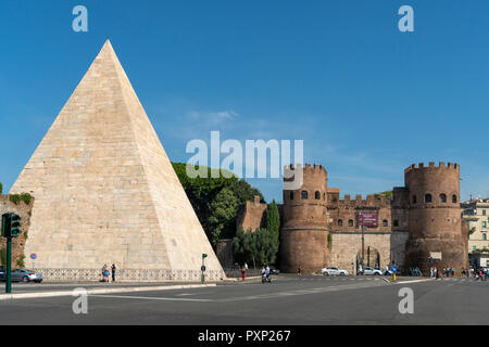 The Pyramid of Cestius and Porta San Paolo, one of the southern gates in the  Aurelian Walls, in the Ostiense district, Rome, Italy. - Stock Photo