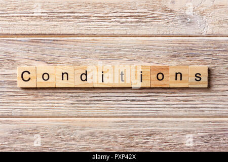 conditions word written on wood block. conditions text on table, concept. - Stock Photo