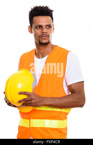 Young African man construction worker holding safety helmet whil - Stock Photo