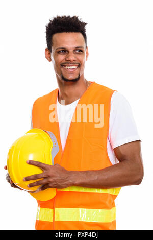 Thoughtful happy African man construction worker smiling while h - Stock Photo