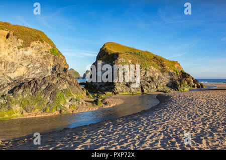 Rocks on Holywell Beach, with a view through  to Carters Rocks, Cornwall, UK - Stock Photo