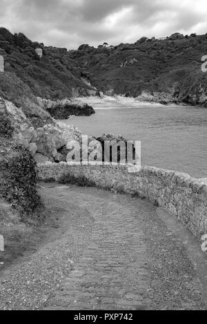 Black and white of saints bay at guernsey, Channel Island - Stock Photo