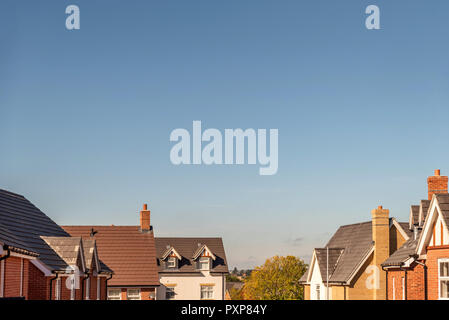 wide view of roof tops of British housing development. - Stock Photo