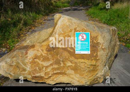 Rocks placed on country path to obstruct riders of motor bikes, Scramblers and Quad bikes from damaging the environment. Greater Manchester, UK. - Stock Photo