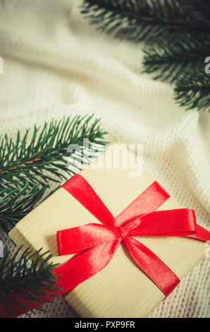 Christmas background with decorations and gift boxes on knitted board blanket. Xmas presents with blank postcard. - Stock Photo