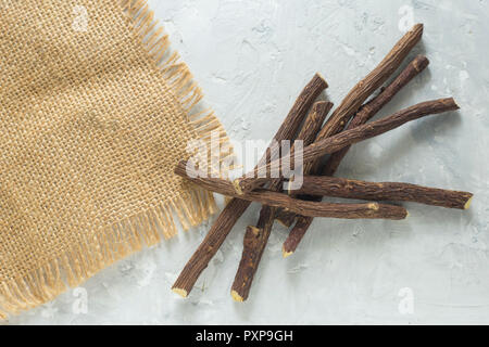 licorice root on the table - Glycyrrhiza glabra. - Stock Photo