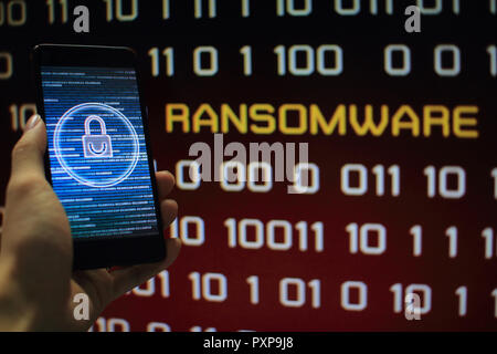 protected in stream of data flow. padlock icon symbolize security and red binary code computer data in the background with ransomware text. - Stock Photo