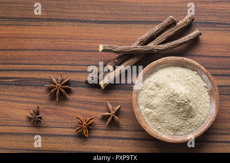 licorice root and flour and anise on the table. - Stock Photo