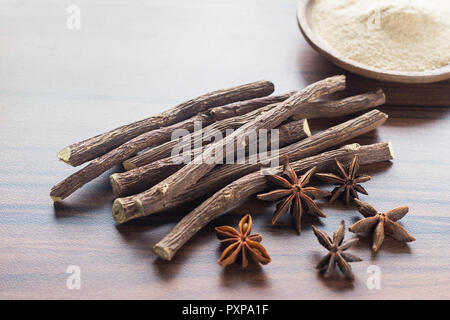 licorice root and anise on the table - Glycyrrhiza glabra. - Stock Photo
