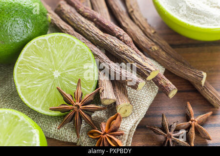 licorice root, lemon and anise on the table. - Stock Photo