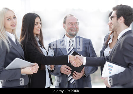 professional business team and shaking hands of young business partners in the office - Stock Photo