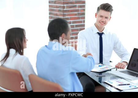 handshake business partners after discussion of the contract. - Stock Photo