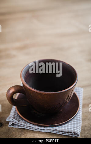 Empty Clay Cup on Wooden Background. Home Wares. Kitchen Decor in Rustic Style. View From Above With Copy Space. - Stock Photo