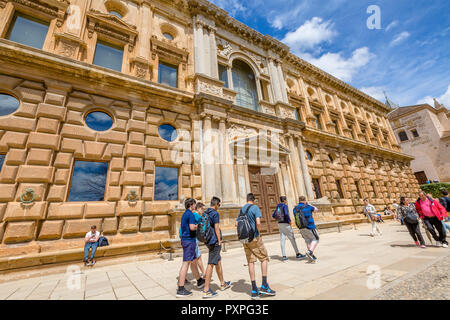 Alhambra of Granada, Andalucia, Spain - April 17, 2016: people walk in front of facade of Charles V Palace, a renaissance building, Unesco Heritage. - Stock Photo