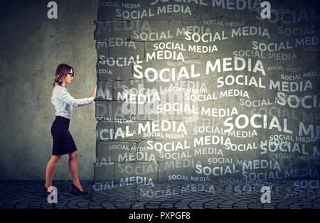Business woman determined to stop social media pressure and influence - Stock Photo