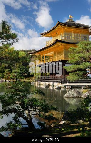 Kinkaku-ji, Temple of the Golden Pavilion, shining in autumn sunlight amidst a pond garden. Officially known as Rokuon-ji, Zen Buddhist temple in Kyot - Stock Photo