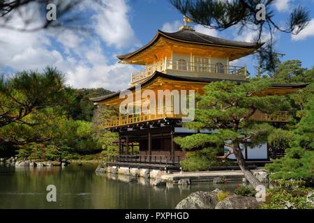 Kinkaku-ji, Temple of the Golden Pavilion, shining in autumn sunlight. Officially known as Rokuon-ji, Zen Buddhist temple in Kyoto, Japan. - Stock Photo