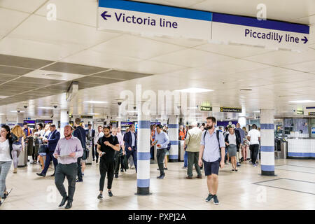 London England United Kingdom Great Britain Piccadilly St. James's Green Park Underground Station subway tube public transportation man woman commuter - Stock Photo