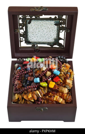 A young woman keeps her beads  necklaces and bracelets in a dusty  mass production  box of mahogany. Isolated on white - Stock Photo