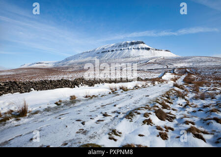 Winter view of Pen-y-Ghent, one of the Yorkshire Three Peaks in the Yorkshire Dales National Park after overnight snow - Stock Photo