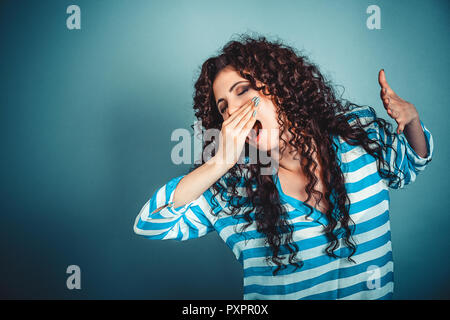 sleepy young woman with wide open mouth yawning eyes closed look - Stock Photo