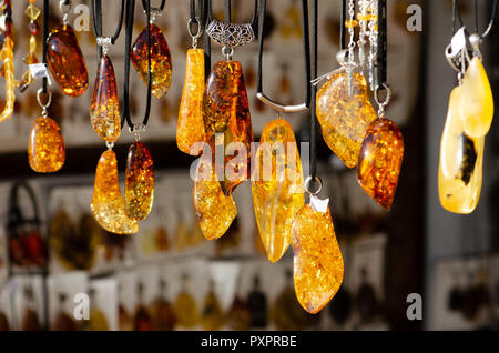 Amber necklace. Amber of different colors and sizes. Exposition of stones of amber for tourists, souvenir - Stock Photo