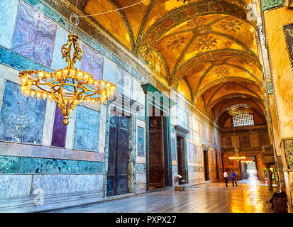 Tourists visiting The Narthex of the Hagia Sophia mosque, an inner hall of nine vaulted bays. Istanbul, Turkey. - Stock Photo