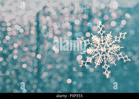 christmas background with highlights and silvery snowflakes - Stock Photo