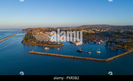 Doheny state beach, drone image of Dana Point Harbor Sunrise In October.  Beautiful sunrise aerial shots of Boats in the harbor. Drone photography. - Stock Photo