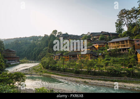 China, Guizhou, Miao settlement at the riverside - Stock Photo