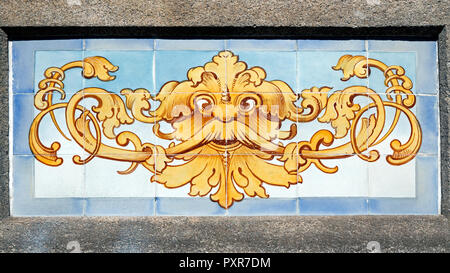 Old traditional glazed tiles - azulejos - used in the decoration of houses facades of Porto, Portugal - Stock Photo
