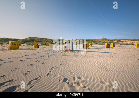 Germany, Lower Saxony, East Frisian Island, Juist, hooded beach chairs on the beach - Stock Photo